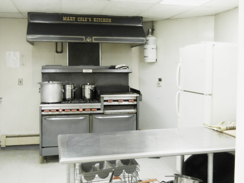 A view of St. Peter's 6-burner stove with 2 ovens and a solid grill.
